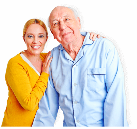 senior man with female caregiver smiling