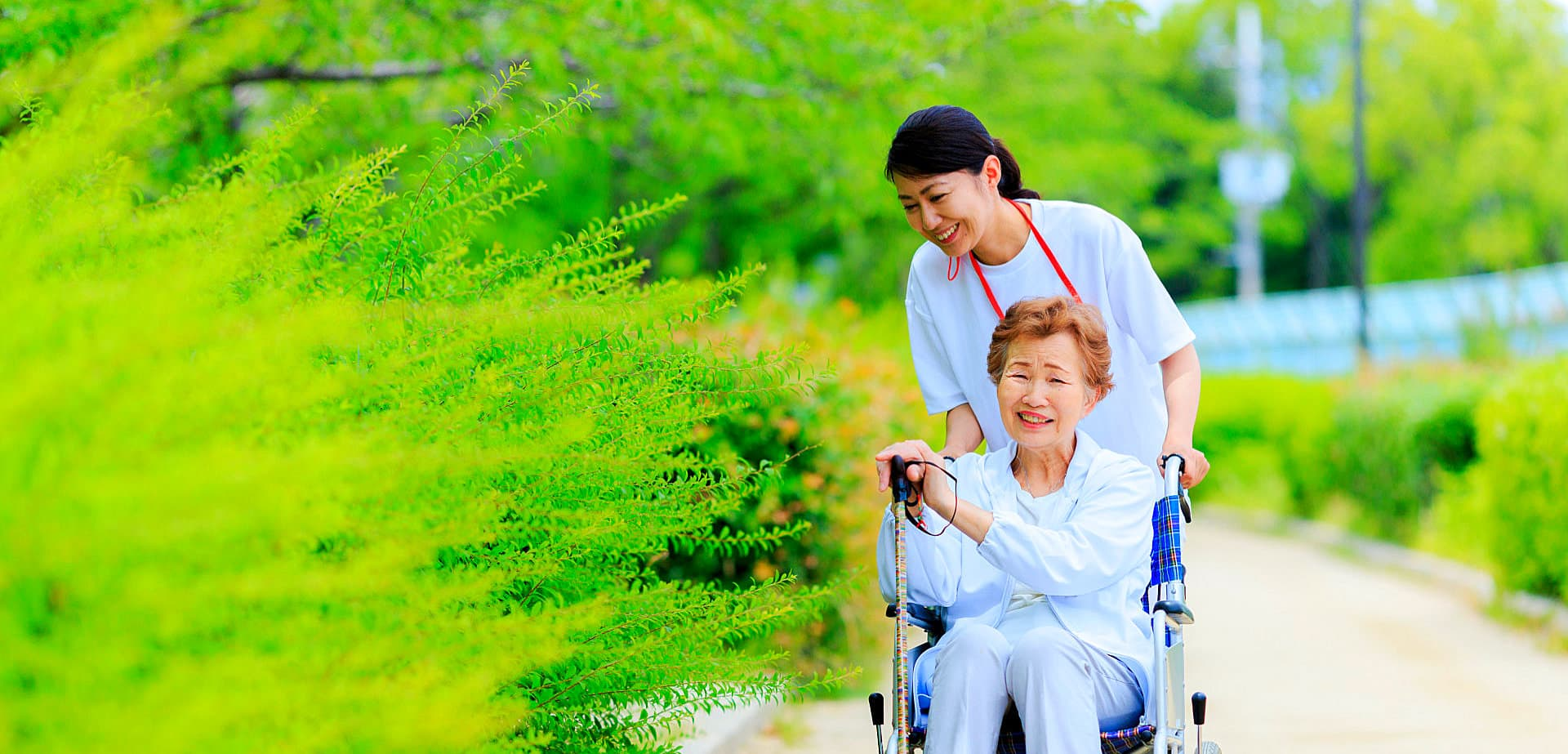 caregiver assisting senior woman on wheelchair